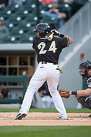 Leury Garcia (24) of the Charlotte Knights at bat against the Toledo Mud Hens at BB&T BallPark on April 27, 2015 in Charlotte, North Carolina.  The Knights defeated the Mud Hens 7-6 in 10 innings.   (Brian Westerholt/Four Seam Images)
