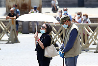 A couple wearing face masks attend Pope Francis' Sunday Angelus noon prayer in St.Peter's Square, at the Vatican, Sunday, June 7, 2020.<br /> UPDATE IMAGES PRESS/Isabella Bonotto<br /> <br /> STRICTLY ONLY FOR EDITORIAL USE