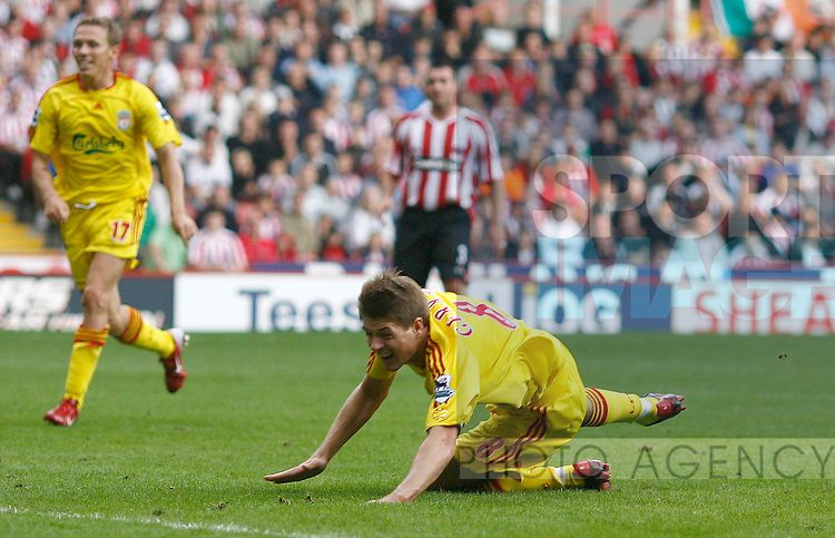Liverpool's Steven Gerrard goes down to earn a penalty