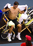 BANGKOK, THAILAND - OCTOBER 01:  Rafael Nadal of Spain chages his jersey on his match against Mikhail Kukushkin of Kazakhstan during the Day 7 of the PTT Thailand Open at Impact Arena on October 1, 2010 in Bangkok, Thailand.  Photo by Victor Fraile / The Power of Sport Images