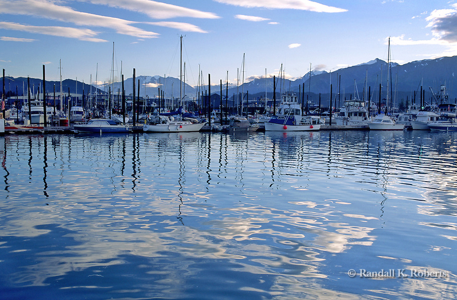 Boats in the harbor of Seward, Alaska on the Kenai Peninsula, at dusk