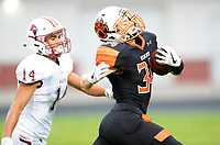 Verona's Keegan Lindell runs past Middleton's Kevin Meicher during Wisconsin Big Eight Conference high school football between Middleton and Verona on Friday, 8/24/18 at Verona High School