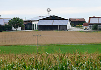 Germany, Bavaria, farm with different energy units and maize field