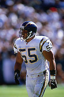 OAKLAND, CA - Junior Seau of the San Diego Chargers in action during a game against the Oakland Raiders at the Oakland Coliseum in Oakland, California in 1997. Photo by Brad Mangin