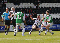 Paul McGowan (centre) passes under pressure from Paul Hanlon (right) in the St Mirren v Hibernian Clydesdale Bank Scottish Premier League match played at St Mirren Park, Paisley on 29.4.12.