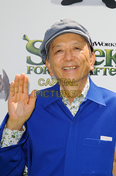 "JAMES HONG .arriving at the Los Angeles premiere of Dreamworks Animation's ""Shrek Forever After"" at Gibson Amphitheatre in Universal City, California, .May 16th, 2010.half length hand blue shirt cap hat .CAP/ROT.©Lee Roth/Capital Pictures"