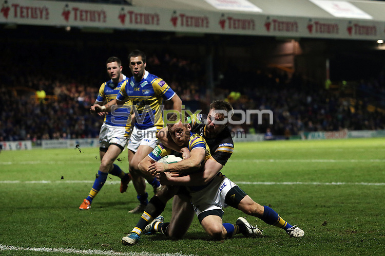 PICTURE BY VAUGHN RIDLEY/SWPIX.COM - Rugby League - Tetley's Challenge Cup, 4th Round - Leeds Rhinos v Castleford Tigers - Headingley, Leeds, England - 19/04/13 - Leeds Rob Burrow scores a try.
