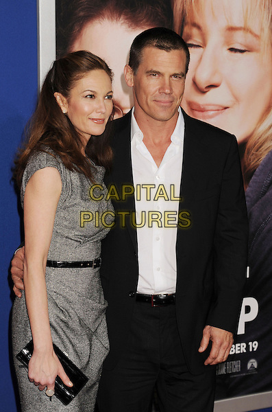 "Diane Lane & Josh Brolin.""The Guilt Trip"" Los Angeles Premiere held at the Regency Village Theatre, Westwood, California, USA..December 11th, 2012.half length dress belt grey gray black clutch bag suit white shirt married husband wife .CAP/ROT/TM.©Tony Michaels/Roth Stock/Capital Pictures"