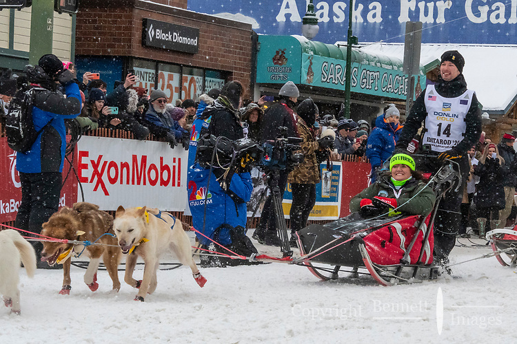Deke Naaktgeboren and team leave the ceremonial start line with an Iditarider and handler at 4th Avenue and D street in downtown Anchorage, Alaska on Saturday March 7th during the 2020 Iditarod race. Photo copyright by Cathy Hart Photography.com