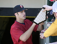 May 28, 2004:  Catcher Joe Mauer (7) of the Rochester Red Wings, Triple-A International League affiliate of the Minnesota Twins, signs autographs before a game at Frontier Field in Rochester, NY.  Photo by:  Mike Janes/Four Seam Images