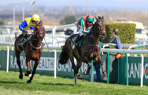 14h April 2018, Aintree Racecourse, Liverpool, England; The 2018 Grand National horse racing festival sponsored by Randox Health, day 3; Tom Scudamore on Mr Big Shot runs on to win The Gaskells Handicap Hurdle with Tom O'Brien on Now McGinty coming in second