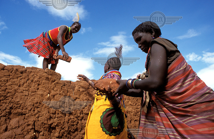 ©Crispin Hughes/Panos Pictures..Uganda, Karamoja. Karamojong women making bricks.