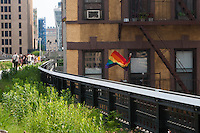 New York, NY -  10 June 2011 A Rainbow Flag, which signifies Gay Pride, waves from the fire escape of a building adjoining the High Line...This week the second section of the Highline, which runs from West 20th street in Chelsea, to 30th Street in Midtown, opened to the public.