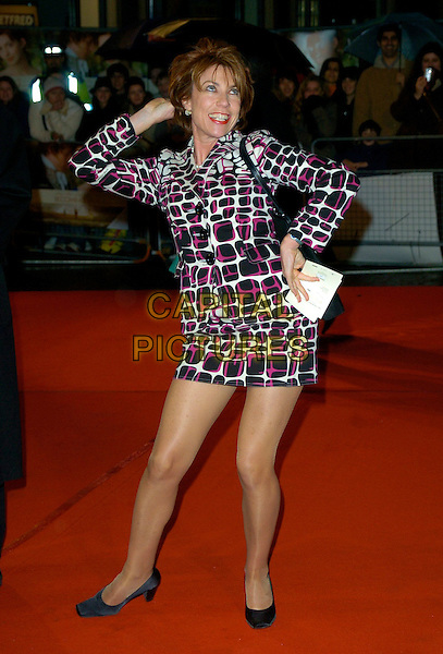 "KATHY LETTE.""Becoming Jane"" World Premiere, Odeon West End, .London, England, March 4th 2007..full length black red white patterned print dress jacket skirt suit pose hand on hip head funny.CAP/CAN.©Can Nguyen/Capital Pictures"