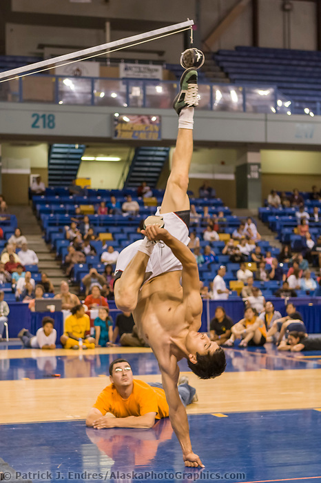 Elijah Cabinboy stretches high during the mens Alaska high kick at the 2008 World Eskimo Indian Olympics held annually in Fairbanks, Alaska.