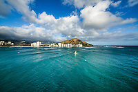 Boaters and others enjoy the ocean off Waikiki and the Gold Coast, with Diamond Head Crater beyond, O'ahu.