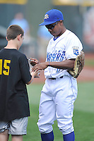 Terrance Gore #6 of the Omaha Storm Chasers signs a ball for a young fan prior to their game against the Las Vegas 51s at Werner Park on August 17, 2014 in Omaha, Nebraska. The Storm Chasers  won 4-0.   (Dennis Hubbard/Four Seam Images)