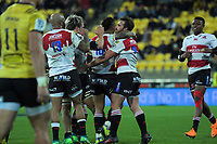 The Lions celebrate Nic Groom's try during the Super Rugby match between the Hurricanes and Lions at Westpac Stadium in Wellington, New Zealand on Saturday, 5 May 2018. Photo: Dave Lintott / lintottphoto.co.nz