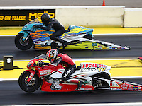 Aug 19, 2016; Brainerd, MN, USA; NHRA pro stock motorcycle rider Hector Arana Jr (near) races alongside Jerry Savoie during qualifying for the Lucas Oil Nationals at Brainerd International Raceway. Mandatory Credit: Mark J. Rebilas-USA TODAY Sports