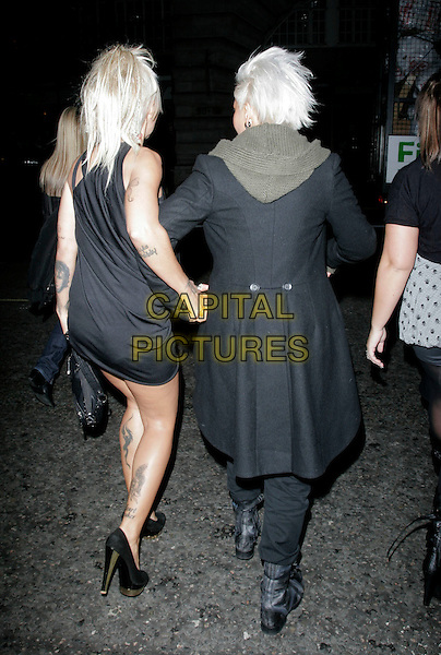 JODIE MARSH & her girlfriend Nina.Seen leaving Volstead Club on their way Chinawhite nightclub, London, England, November 11th 2008..full length black dress shoes couple  girlfriend biker boots coat holding hands back rear behind .CAP/AH.©Adam Houghton/Capital Pictures