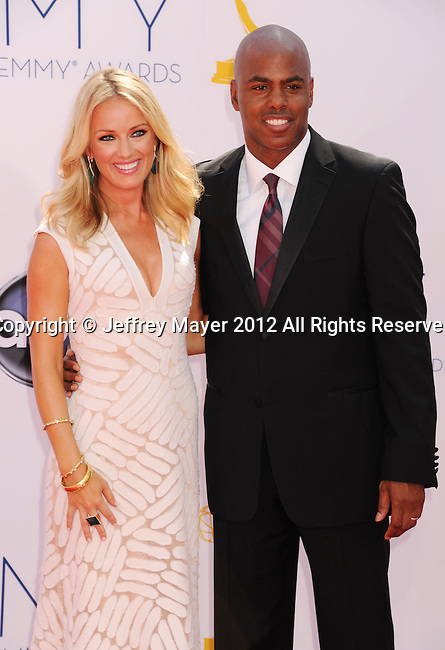 LOS ANGELES, CA - SEPTEMBER 23: Brooke Anderson and Kevin Frazier arrive at the 64th Primetime Emmy Awards at Nokia Theatre L.A. Live on September 23, 2012 in Los Angeles, California.