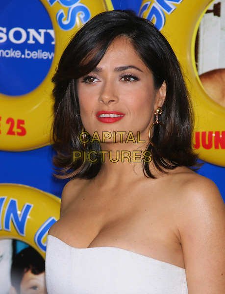 "SALMA HAYEK PINAULT.The New York Premiere of ""Grown Ups"" at the Ziegfeld Theater, New York, NY, USA..June 23rd, 2010.headshot portrait red lipstick make-up strapless white cleavage.CAP/LNC/TOM.©TOM/LNC/Capital Pictures."