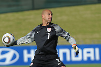 U.S. goalkeeper Tim Howard quickly distributes ball from a thwarted Australian attack on the Americans' goal. The U.S. won the match, 3-1, played June 5th, in Ruimsig Stadium,  at Roodepoort, South Africa.
