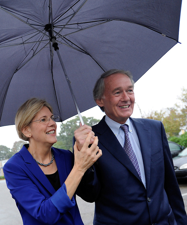 Elizabeth Warren, candidate for U.S. Senate, left, shares an umbrella with Congressman Ed Markey during a campaign visit to Medford on Wednesday, October 03, 2012.