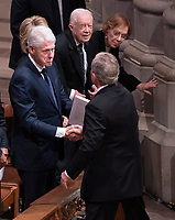 December 5, 2018 - Washington, DC, United States: Former President George W. Bush greets Bill Clinton, Hillary Clinton, Jimmy Carter and Rosalyn Carter as he arrives at the state funeral service of his father former President George W. Bush at the National Cathedral.  <br /> <br /> CAP/MPI/RS<br /> &copy;RS/MPI/Capital Pictures