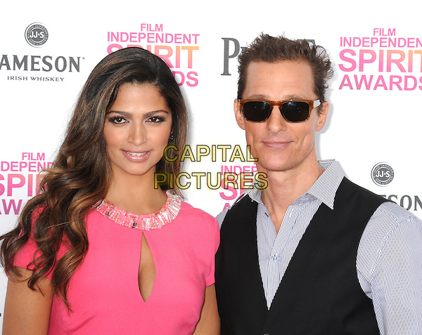 Camila Alves, Matthew McConaughey.2013 Film Independent Spirit Awards - Arrivals Held At Santa Monica Beach, Santa Monica, California, USA,.23rd February 2013..indy indie indies indys headshot portrait sunglasses brown shades striped white shirt pinstripe waistcoat pink married husband wife cut out cleavage sunglasses shades dress shades  .CAP/ROT/TM.© TM/Roth/Capital Pictures