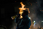 A horseman drinka typical liqueur before jumps over a bonfire in the Spanish  village of San Bartolome de Pinares in the province of Avila, Castile and Leon, Spain, during the opening of the traditional religious festival Luminarias; in honour of San Antonio Abad (Saint Anthony), patron saint of animals. January  16, 2017. (ALTERPHOTOS/Rodrigo Jimenez)