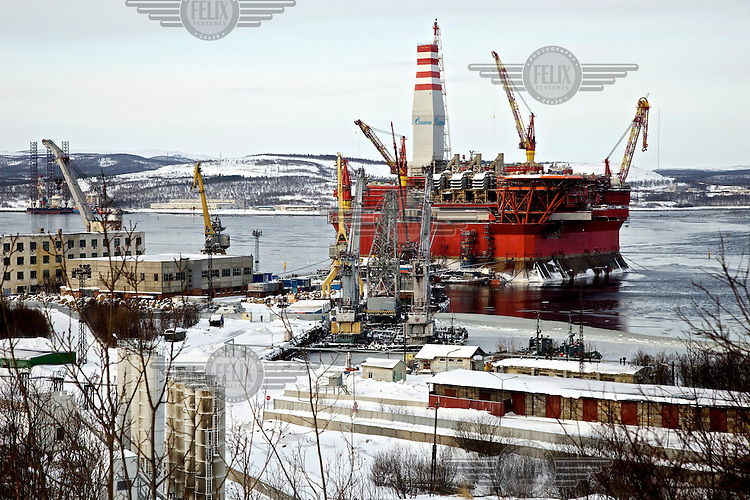 The ice-resistant Prirazlomnaya oil platform being outfitted and pre-commissioned by Gazprom on the coast of Murmansk City. When finished it will be towed to the Prirazlomnoye oil field in the eastern Pechora Sea. The platform has been under construction at the Sevmash Yard for 15 years and is designed to operate on Russia's first offshore hydrocarbon field in the Arctic. It will be operated by a crew of about 200 men working on two-week shifts. The field holds resources of up to 41 million tons and annual peak production is believed to amount to about six million tons. A total of 36 wells will be drilled at the site by year 2019. /Felix Features