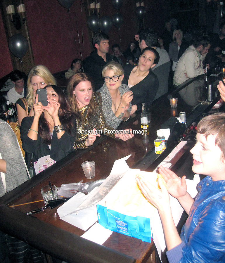 February 28th 2011 Exclusive  Friday Night ...Kelly OsBourne partying & celebrating a friends birthday while drinking Corona beer & taking shots at The Bronson bar in Los Angeles with friends. Kelly was wearing black frame glasses & showing off her cleavage. Tattoo ..AbilityFilms@yahoo.com.805-427-3519 .www.AbilityFilms.com.