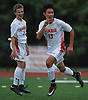 Jose Pena #13 of Chaminade, right, reacts after scoring the game-winning goal with 5.4 seconds remaining in regulation of a NSCHSAA varsity boys soccer match against host St. John the Baptist High School on Tuesday, Sept. 11, 2018. Chaminade won by a score of 4-3. Reacting in background is teammate Daniel Loumeau #2.