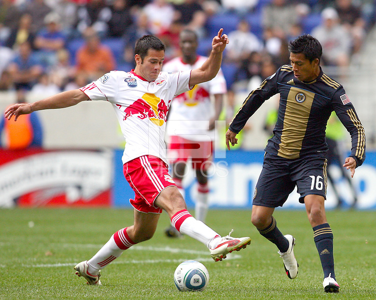 Michael Oroxco #16 of the Philadelphia Union pushes the ball past Mike Petke #12 of the New York RedBulls during a MLS  match on April 24 2010, at RedBull Arena, in Harrison, New Jersey.