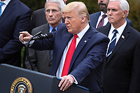United States President Donald J. Trump declares a national emergency due to the COVID-19 coronavirus pandemic in the Rose Garden of the White House on March 13, 2020 in Washington, DC.  Lookin on at top center is Director of the National Institute of Allergy and Infectious Diseases at the National Institutes of Health Dr. Anthony Fauci and at left is US  Vice President Mike Pence.<br /> Credit: Oliver Contreras / Pool via CNP/AdMedia