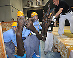 """June 21th, 2011, Tokyo, Japan - Workers take replica skeletons out of crates before assembling a skeletal model of the Tyrannosaurus at the National Science Museum in Tokyo on Tuesday, June 21, 2011. The Tyrannosaurusthe greatest carnivorous dinosaur inhabiting the North American Continent about 70 million to 65 million years agowill face the Triceratops in the special exhibition """"Dinosaurs Expo 2011"""" at the museum in July. (Photo by Natsuki Sakai/AFLO)"""