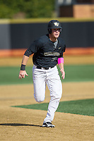 Gavin Sheets (24) of the Wake Forest Demon Deacons hustles towards third base against the Florida State Seminoles at David F. Couch Ballpark on April 16, 2016 in Winston-Salem, North Carolina.  The Seminoles defeated the Demon Deacons 13-8.  (Brian Westerholt/Four Seam Images)