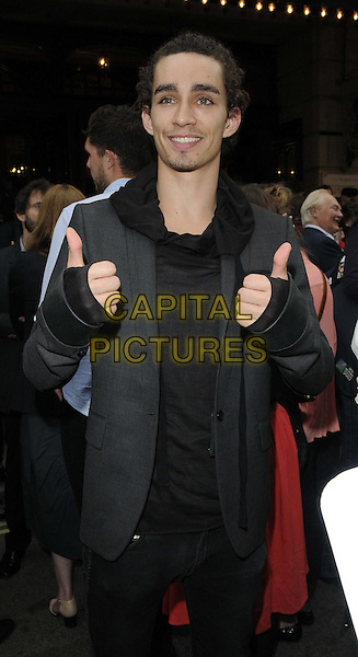 Robert Sheehan<br /> The &quot;The Cripple of Inishmaan&quot; press night performance, Noel Coward Theatre, St Martin's Lane, London, England.<br /> June 18th, 2013<br /> half length grey gray suit jacket black top hands thumbs up fingerless gloves <br /> CAP/CAN<br /> &copy;Can Nguyen/Capital Pictures