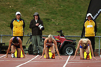 Auckland's Monique Williams (centre) prepares to race in the women's 100m final during the National athletics championships at Newtown Park, Wellington, New Zealand on Friday, 27 March 2009. Photo: Dave Lintott / lintottphoto.co.nz
