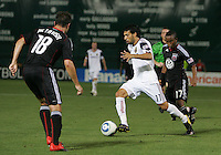 Devon McTavish #18 and Boyzzz Khumalo #17 of D.C. United try to stop Javier Morales #11  of Real Salt Lake during an Open Cup match at RFK Stadium, on June 2 2010 in Washington DC. DC United won 2-1.