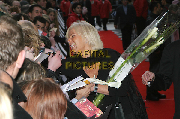 ANNI-FRID LYNGSTAD  - ABBA.FRIDA.Mama Mia! 5th anniversary show at the Prince Of Wales Theatre.06 April 2004.signing autographs, fans, crowd, flowers.www.capitalpictures.com.sales@capitalpictures.com.© Capital Pictures.