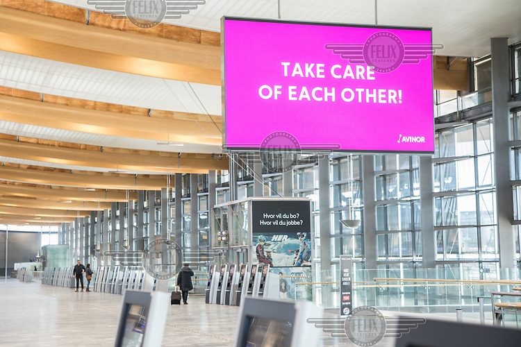 Signs from the Norwegian authorites made to remind people how to stay safe during the corona crisis. <br />  <br /> Norwegian authorites introduced measures to combat the Coronavirus (COVID-19)  leaving Gardermoen Airport, near the Norwegian capital Osl, deserted. <br /> <br /> Restriction on public gatherings and travel have grounded most airplanes, and stopped nearly all domestic and foreign travel. <br /> <br />  Like most capitals, Oslo is usually busy on a Saturday night. But on the first weekend after Norwegian authorites introduced measures to combat the Coronavirus (COVID-19) the city was almost deserted. <br /> <br /> Restriction on public gatherings, closure of schhols, new rules for those serving food and drinks, and fear of further spread of the virus compelled most bars and restaurants to close. <br /> <br /> 28,5 million passangers used the airport in 2018, with the airline Norwegian flying the most people. At teh time of writing Norweigan is on the verge of bankruptcy, and hoping to get governemnt aid to surive the economic crisis caused by the corona virus.  <br /> <br /> <br /> ©Fredrik Naumann/Felix Features