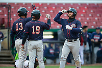 Cedar Rapids Kernels Chris Williams (32) is congratulated by Estamy Urena (13) and Gabriel Maciel (19) after hitting a home run during a Midwest League game against the Kane County Cougars at Northwestern Medicine Field on April 28, 2019 in Geneva, Illinois. Cedar Rapids defeated Kane County 3-2 in game two of a doubleheader. (Zachary Lucy/Four Seam Images)