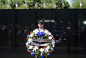 A soldier holds a wreath during a ceremony to commemorate the 50th anniversary of the Vietnam War at the Vietnam Veterans Memorial in Washington, D.C. on Monday, May 28, 2012..Credit: Kristoffer Tripplaar  / Pool via CNP