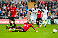 Saturday 17 August 2013<br /> <br /> Pictured: Michu of Swansea gets the balll past Rio Ferdinand of Manchester United<br /> <br /> Re: Barclays Premier League Swansea City v Manchester United at the Liberty Stadium, Swansea, Wales
