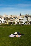 California: San Francisco. People relaxing in Alamo Square with view of Victorians and modern downtown. Photo copyright Lee Foster. Photo #: san-francisco-alamo-square-20-casanf77512