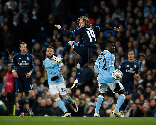 26.04.2016. The Etihad, Manchester, England. UEFA Champions League. Manchester City versus Real Madrid. Real Madrid midfielder Luka Modric wins an aerial challenge against Manchester City striker Kelechi Iheanacho.