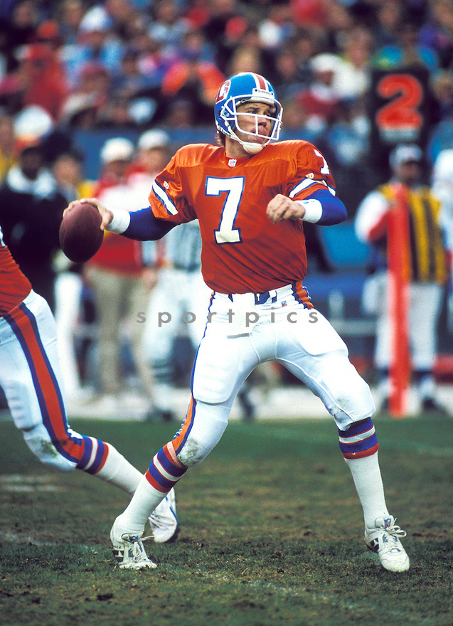 Denver Broncos John Elway(7) in action during a game from his career.  John Elway play for 16 seasons, all with the Denver Broncos.  John Elway was a 9-time Pro Bowler and was inducted to the Pro Football Hall of Fame in 2004.