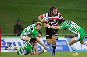 Tana Umaga pushes off Shannon Paku. ITM Cup rugby game between Counties Manukau and Manawatu played at Bayer Growers Stadium on Saturday August 21st 2010..Counties Manukau won 35 - 14 after leading 14 - 7 at halftime.